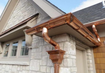 Rain-Gutter-Installation-With-Stone-Wall